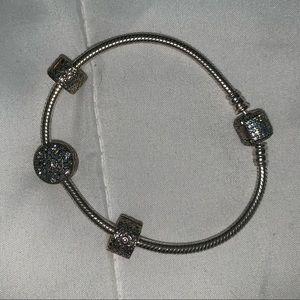 Authentic Pandora charm bracelet with three charms